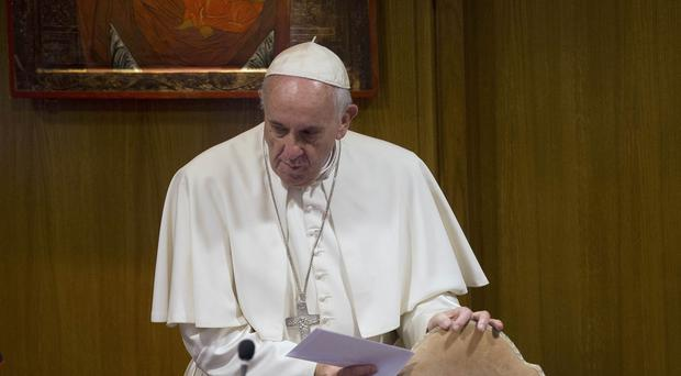 Pope Francis has visited homeless people at the Vatican's new shelter