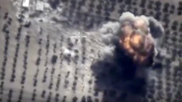 A target is hit during a Russian air raid in Syria (AP/ Russian Defence Ministry Press Service)