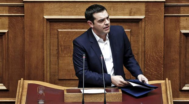Alexis Tsipras delivers a speech to policymakers ahead of the parliamentary vote. (AP)