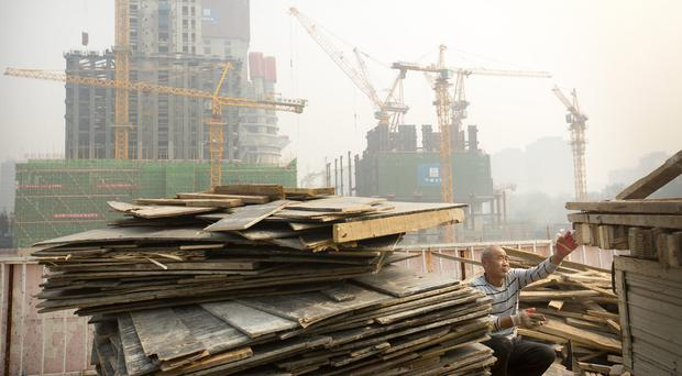China's economy grew by 6.9% in the three months ended in September (AP)