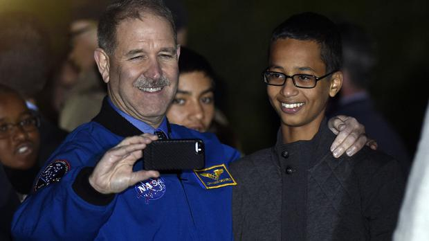 Selfie respect: John Grunsfeld, Nasa's Science Mission Directorate associate administrator, takes a photo with Ahmed Mohamed, right, at the White House (AP)