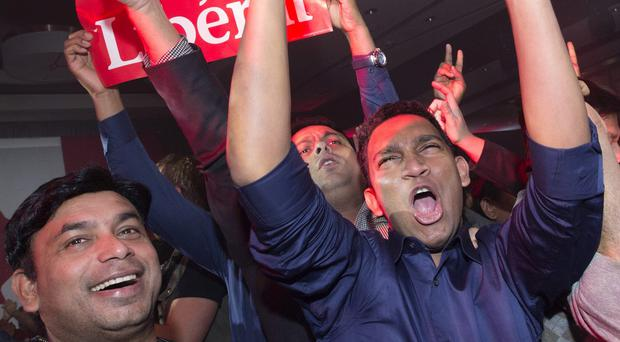 Supporters celebrate at Liberal party headquarters in Montreal (The Canadian Press/AP)