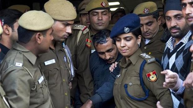 Shiv Kumar Yadav, centre, at an earlier court appearance in New Delhi (AP)