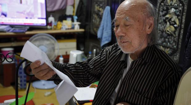 South Korean Kim Wu-jong, 87, is travelling to North Korea to meet his younger sister (AP)