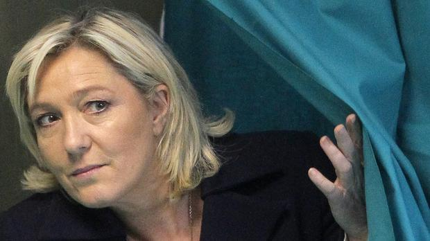 Marine Le Pen, leader of France's National Front, is on trial for charges of inciting racial hatred (AP)