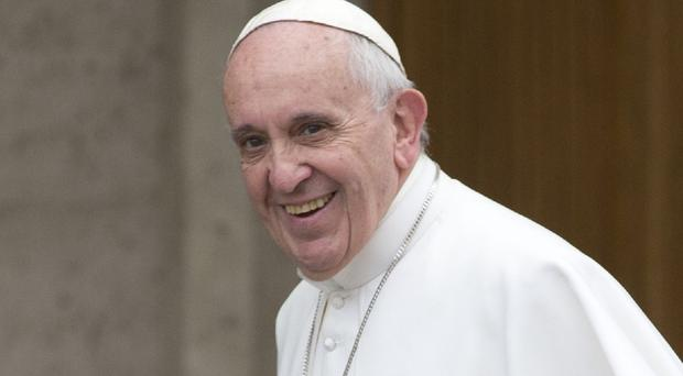 Reports that Pope Francis has a small, curable brain tumour have been denied (AP)