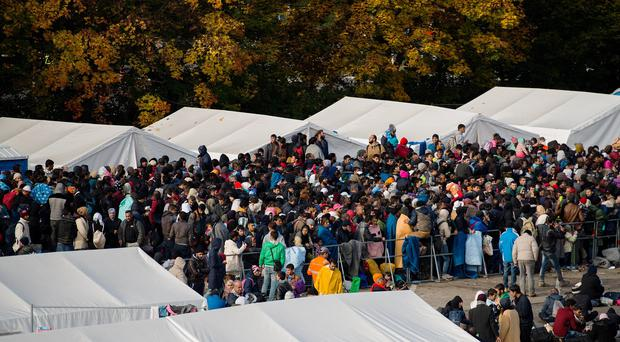 Migrants wait for transfer after they crossed the Austrian-Slovenian border in Spielfeld, Austria. (AP)