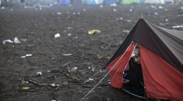 A girl peers out of a tent close to Serbia's border with Croatia, in Berkasovo. (AP)