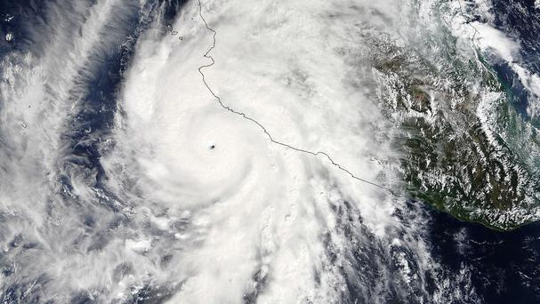 The pinhole eye of Hurricane Patricia moves towards south-western Mexico (Goddard MODIS Rapid Response Team/Nasa/AP)