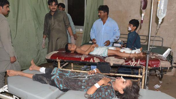 Children injured in a bomb attack being treated at a local hospital in Jacobabad (AP)