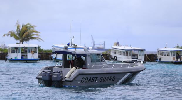 A Coast Guard vessel patrols the area before the arrival of Vice President Ahmed Adheeb near the International Airport in Male, Maldives. (AP)