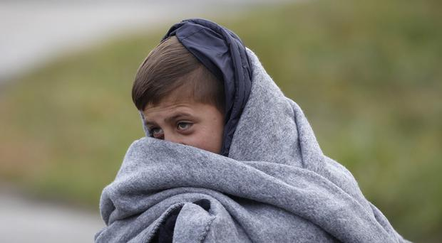 A young boy walks towards Austria from a camp in Sentilj, Slovenia (AP)