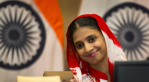 Geeta, 23, smiles during a press conference in New Delhi, India (AP)