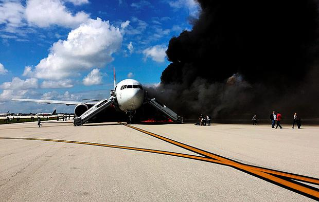 Smoke billows from a 767 plane's engine after it caught fire on the runway of Fort Lauderdale airport in Florida
