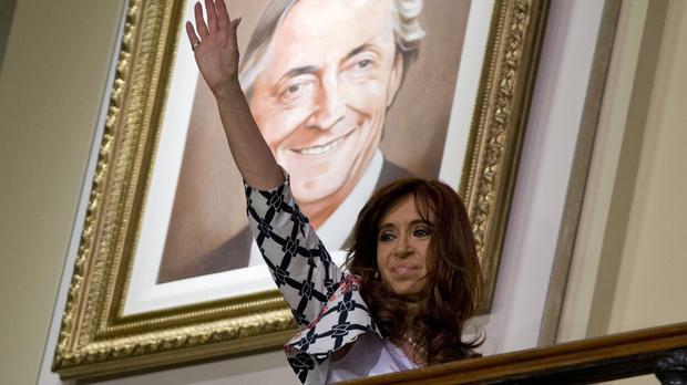 President Cristina Fernandez waves at the crowds from the government house in Buenos Aires (AP)