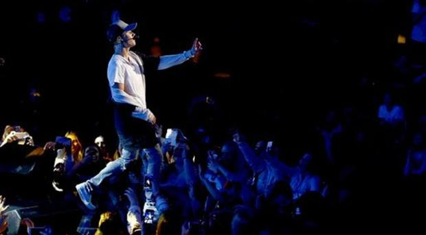 Singer Justin Bieber performs on stage during a mini concert in Oslo (Heiko Junge, NTB scanpix via AP)