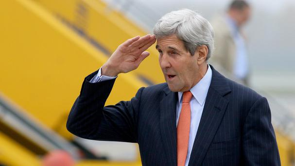 John Kerry arrives in Vienna for talks on ending the Syrian war. (AP)