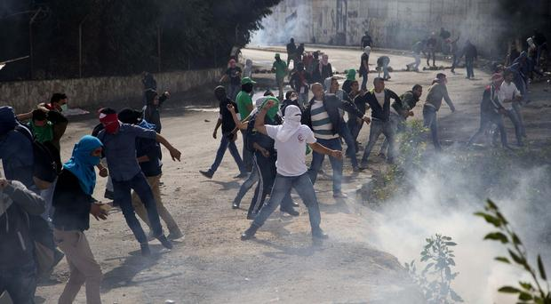 Palestinians clash with Israeli troops in the West Bank village of Abu Dis. (AP)