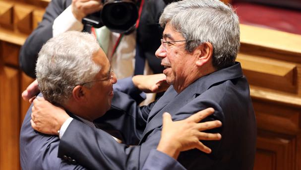 Eduardo Ferro Rodrigues, right, is congratulated by Antonio Costa after being elected president. (AP)
