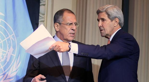 Sergey Lavrov, left, and John Kerry arrive for a press conference after a meeting in Vienna (AP)