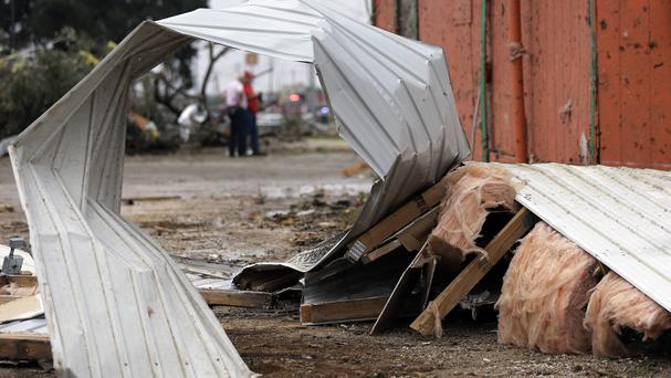Twisted siding and other debris lies on the ground after a suspected tornado hit Floresville, Texas (AP)