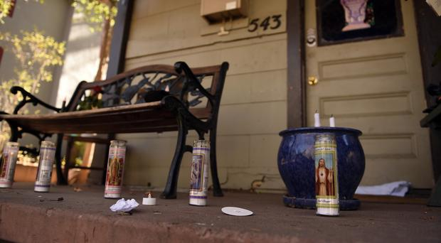 Memorial candles burn on the front porch of a home in East Platte Avenue in a tribute to the victims of the Colorado Springs shootings (The Gazette/AP)