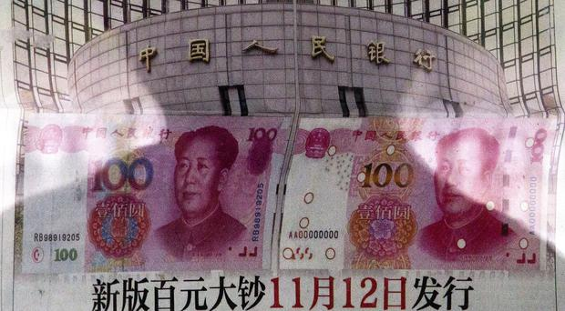The Communist Party also announced plans to let China's tightly-controlled currency trade freely by 2020 (AP)