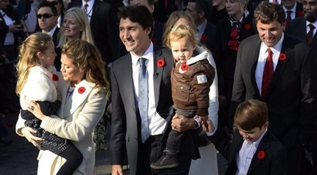 New Canadian PM Justin Trudeau with his wife Sophie Gregoire-Trudeau and their children (Sean Kilpatrick/The Canadian Press, via AP)