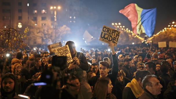 A rally in Bucharest calling for early elections after the nightclub fire. (AP)