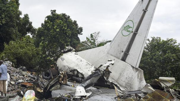 Responders pick through the wreckage of a cargo plane which crashed in the capital Juba, South Sudan (AP)