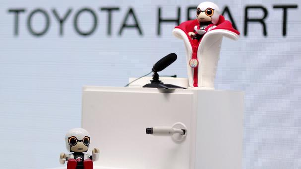 Toyota's Kirobo Mini, a compact sized humanoid communication robot, is seen at the Tokyo Motor Show (AP)