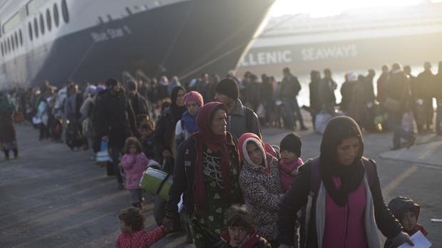 People queue in order to board a ferry at the port of Mytilene on the island of Lesbos, Greece (AP)