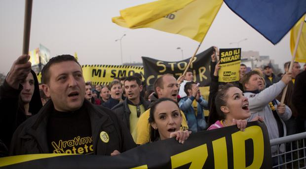 Members and supporters of Zivi Zid political party rally in front of the building of state TV in Zagreb (AP)
