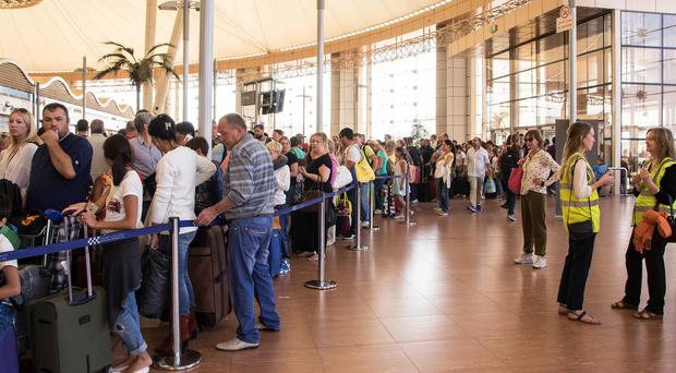 Tourists line up for luggage screening at Sharm el-Sheikh airport (AP)