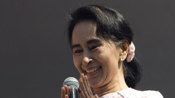 Aung San Suu Kyi urged her supporters not to provoke their losing rivals who are backed by the military (AP)