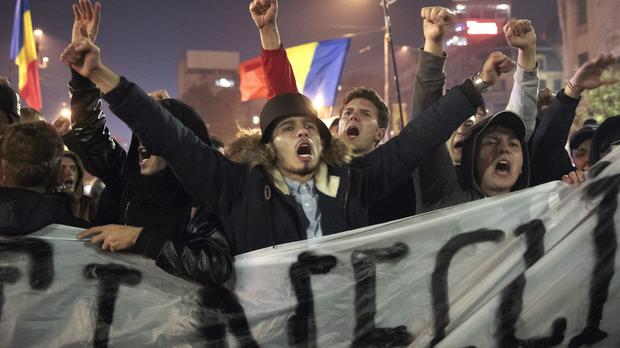 Romanians have staged days of protests calling for an end to corruption and better governance (AP)