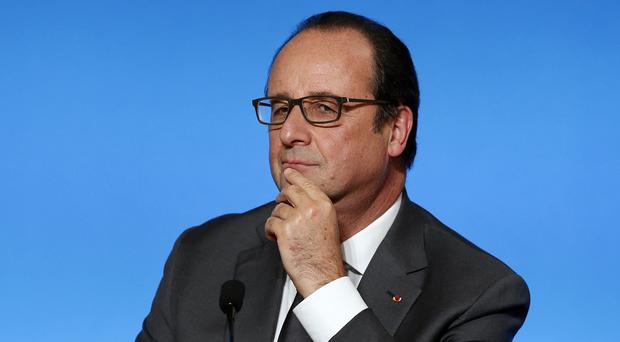 French president Francois Hollande looks on during a press conference at the Elysee Palace as part of the upcoming climate conference in Paris (AP)
