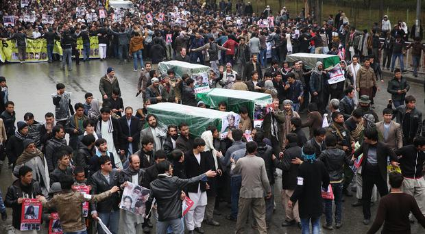 Protesters march through the Afghan capital of Kabul carrying the coffins of seven ethnic Hazaras who were allegedly killed by the Taliban (AP)