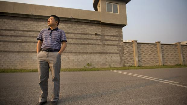 Chinese journalist Liu Hu outside the detention centre where he was held on the outskirts of Beijing (AP)
