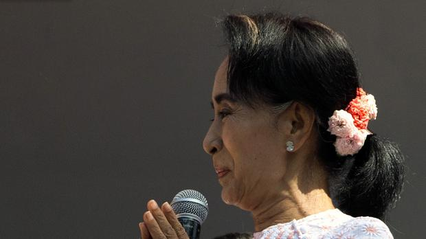 Aung San Suu Kyi's opposition party passed the threshold it needed of 329 seats for a majority in the 664-member parliament (AP)