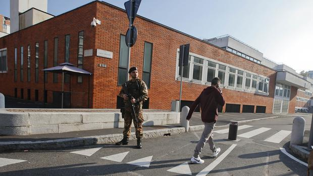 An Italian soldier patrols in front of the David Schaumann Jewish school in Milan after a Jewish man was stabbed in the city (AP)