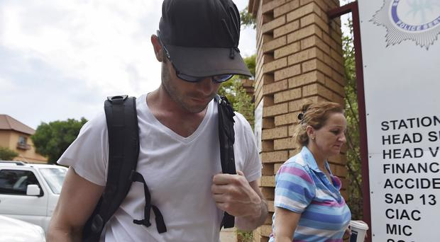 Oscar Pistorius reports for community service at Garsfontein police station in Pretoria. (AP)