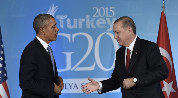 Turkish president Recep Tayyip Erdogan waits to shake the hand of Barack Obama, following their meeting in Antalya (AP)
