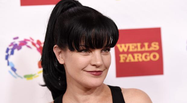Pauley Perrette says a homeless man attacked and threatened to kill her (Invision/AP)