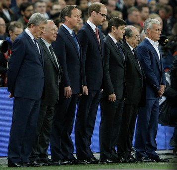England manager Roy Hodgson (left), PM David Cameron (third left), Prince William (fourth left) and France's coach Didier Deschamps (far right) observe a minute's silence before the start of the friendly football match between England and France last night
