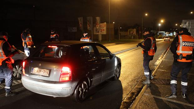 Customs officers check vehicles at the border crossing between France and Belgium in Neuville-en-Ferrain (AP)