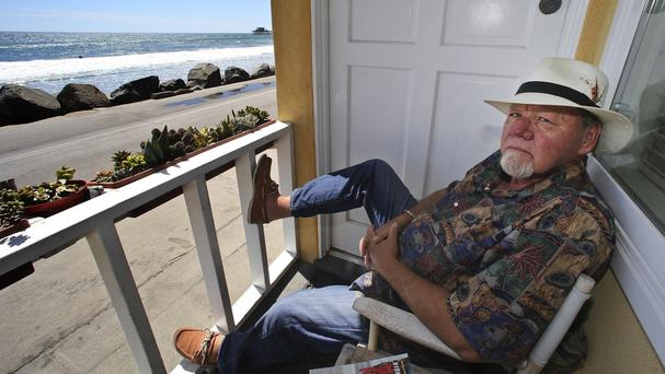 Michael Gross on the porch of his California bungalow where he produced his art (AP)