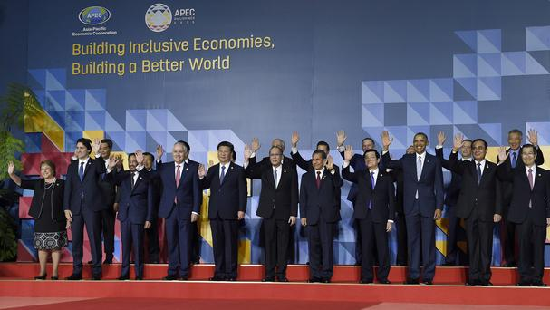 Asia-Pacific Economic Co-operation summit leaders pose for a 'family photo' (AP)