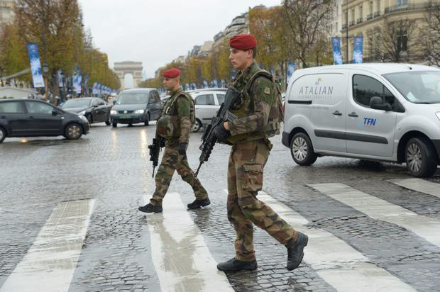 French soldiers patrol on the Champs-Elysees