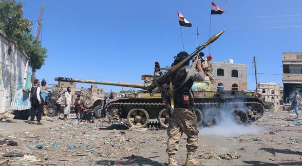 Tribal fighters prepare to take their positions on a street in Yemen (AP)